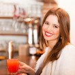 Woman drinking a cocktail — Stock Photo #29930577