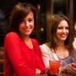 Friends having great time in a pub — Stock Photo