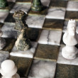 Chess pieces on a marble board — Stock Photo