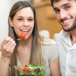Young couple eating together dietetic food — Stock Photo