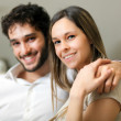 Happy couple on the sofa — Stock Photo