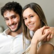 Stock Photo: Happy couple on the sofa