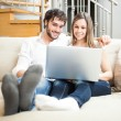 Foto Stock: Couple using notebook