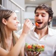 Couple eating a salad — Stock Photo