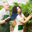 Workers examining plants — Stock Photo #30024893