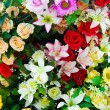 Composition of artificial flowers in a greenhouse — Stock Photo