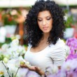 Beautiful woman in a floral environment — Stock Photo