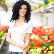 Beautiful woman in a greenhouse — Stock Photo