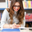 Female student in a library — Stock Photo #30026817