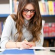 Stock Photo: Female student in a library