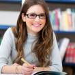 Female student in a library — Stock Photo #30026999
