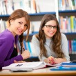 People studying together in a library — Stockfoto