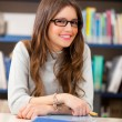 Beautiful girl in a library — Stock Photo