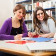 Students in a library — Stock Photo #30027311
