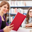 Students in a library — Stock Photo #30027345