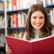 Girl in a library — Stock Photo #30027375