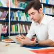 Stock Photo: Student using his tablet