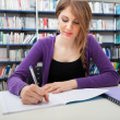 Portrait of a student in a library — Stock fotografie