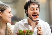 Young man eating a healthy salad — Stock Photo