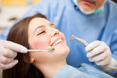 Dentist doing a treatment — Stock Photo