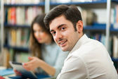 Two students in a library — Stock Photo