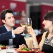 Couple toasting wineglasses in a restaurant — Stock Photo #30138147