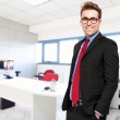 Confident young businessman in his office — Stock Photo