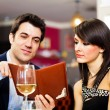 Couple reading menu — Stock Photo #30137873