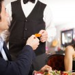 Man paying dinner — Stock Photo