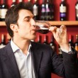 Stock Photo: Sommelier tasting wine glass