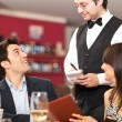 Couple ordering dinner in a restaurant — Stock Photo #30137907