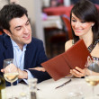 Couple reading menu in restaurant — Stok Fotoğraf #30137941