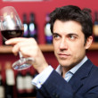 Man analyzing a glass of wine — Stock Photo