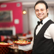 Stock Photo: Smiling waiter portrait