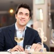 Stock Photo: Handsome man eating at the restaurant