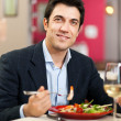 Handsome man eating at the restaurant — Stock Photo #30138103