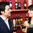Стоковое фото: Couple toasting wineglasses in luxury restaurant