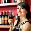 Beautiful woman holding a glass of wine — Stok fotoğraf