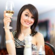 Stock Photo: Beautiful woman holding a glass of wine