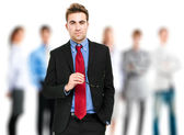 Portrait of a smiling businessman in front of his team — Stock Photo