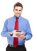 Ung affärsman med sin tablet PC — Stockfoto