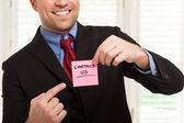 Businessman showing a post-it — Stock Photo