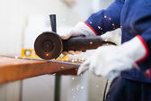 Worker cutting a metal plate — Stock Photo