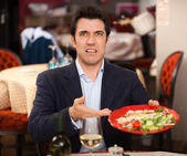 Man complaining for the bad food — Stock Photo