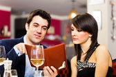 Couple reading menu — Stock Photo