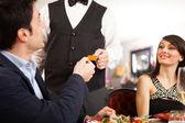 Man paying dinner — Stock Photo