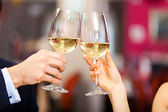 Couple toasting wineglasses — Stock Photo