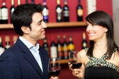 Couple toasting wineglasses in a luxury restaurant — Stock Photo