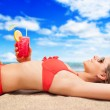 Woman relaxing on the beach — Stock Photo #30185679
