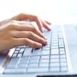 Female hands typing on a laptop — Stock Photo #30187317